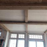 Antique reclaimed resawn white oak faux beams.