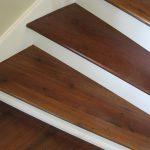 Antique reclaimed walnut flooring resawn from barn beams.